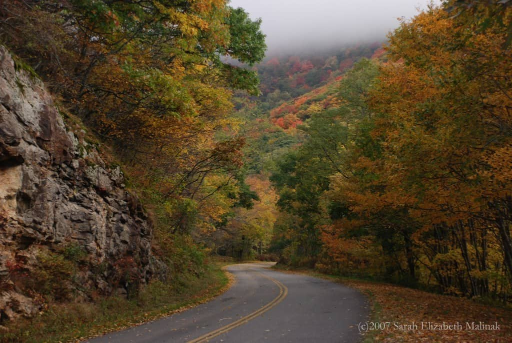 autumn mountain road wlow lying clouds
