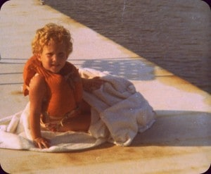 Sallie in life jacket & towel on dock