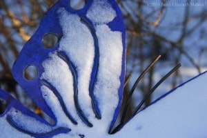 wrought iron Butterfly dusted in snow