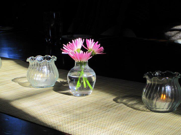 pink-flowers-and-tea-candles-on-table